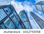 modern office building against... | Shutterstock . vector #1012753558