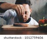 close up chef putting salt on... | Shutterstock . vector #1012759606
