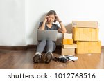 stressed women sitting at... | Shutterstock . vector #1012768516