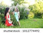 gardening   woman with organic... | Shutterstock . vector #1012774492