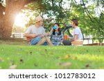 happy asian family picnic in... | Shutterstock . vector #1012783012