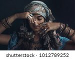gypsy style young woman wearing ...   Shutterstock . vector #1012789252