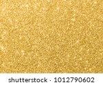 gold glitter texture sparkling... | Shutterstock . vector #1012790602