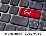 Gift concepts or buying a gift online, with a message on keyboard enter key. - stock photo