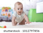 funny baby boy crawling on... | Shutterstock . vector #1012797856