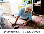elderly woman fell on the floor | Shutterstock . vector #1012799926