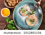 baked apples with cinnamon ... | Shutterstock . vector #1012801156