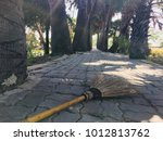 Small photo of Put down a broom on the footpath.