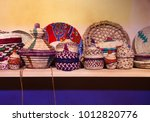 neatly woven colourful baskets... | Shutterstock . vector #1012820776