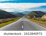 highway in a mountainous area | Shutterstock . vector #1012840972