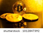 bitcoin. several coins of... | Shutterstock . vector #1012847392