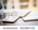 close up eyes glasses on laptop ... | Shutterstock . vector #1012867132