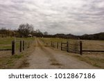 dirt lane leading to a... | Shutterstock . vector #1012867186
