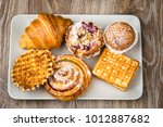 photo of pastry on wooden... | Shutterstock . vector #1012887682