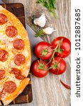 photo of a hot pizza on wooden... | Shutterstock . vector #1012887685