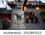 """Small photo of Editorial Beijing, China - January 24, 2018: Guangji Temple """"China key cultural relics protection units"""". The Buddhists kowtow and pray before """"the temple of the king of heaven""""."""