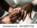 man proposing to his girlfriend | Shutterstock . vector #1012897156