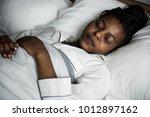 a woman sleeping soundly | Shutterstock . vector #1012897162