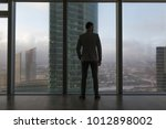 rearview of a businessman... | Shutterstock . vector #1012898002