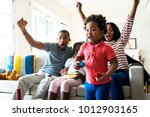 african family spending time... | Shutterstock . vector #1012903165
