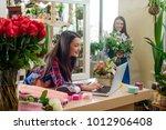 women working in flower shop.... | Shutterstock . vector #1012906408