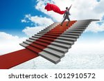 superhero businessman climbing... | Shutterstock . vector #1012910572