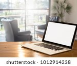 laptop on wood desks blurred ... | Shutterstock . vector #1012914238
