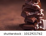 melted chocolate pouring into a ... | Shutterstock . vector #1012921762