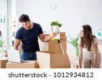 young family unpacking at new... | Shutterstock . vector #1012934812