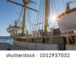 a sailboat with boats. backlight | Shutterstock . vector #1012937032