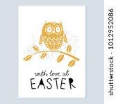 easter card. owl  branch... | Shutterstock .eps vector #1012952086