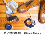 Small photo of Close-up of Premium Tan Brogue Leather Boot with Set of Cleaning Accessories,Wax and Cloth. Horizontal Shot
