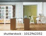 contemporary office interior... | Shutterstock . vector #1012962352
