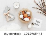 nest with white and brown... | Shutterstock . vector #1012965445