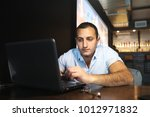 armenian handsome man working... | Shutterstock . vector #1012971832