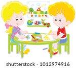 little children drawing funny...   Shutterstock .eps vector #1012974916