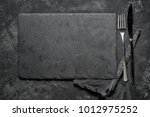 Black Stone Board With Fork An...