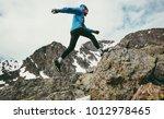 travel man running in mountains ...   Shutterstock . vector #1012978465