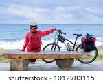 woman bicyclist cycle around... | Shutterstock . vector #1012983115
