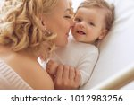 a woman with a baby | Shutterstock . vector #1012983256