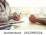 doctors and patients sit and... | Shutterstock . vector #1012985218