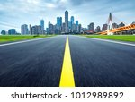 highway leading to the city ... | Shutterstock . vector #1012989892