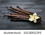 vanilla sticks and flower on... | Shutterstock . vector #1013001295