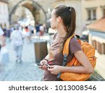 a young smiling woman tourist... | Shutterstock . vector #1013008546