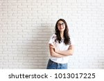 young attractive woman wearing... | Shutterstock . vector #1013017225