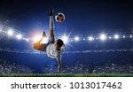 Soccer Player At Stadium. Mixe...