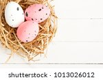quail eggs on the hay. easter... | Shutterstock . vector #1013026012