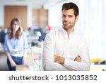 confident young businessman... | Shutterstock . vector #1013035852