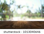 image of wooden table in front... | Shutterstock . vector #1013040646