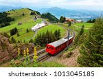 a sightseeing train traveling... | Shutterstock . vector #1013045185